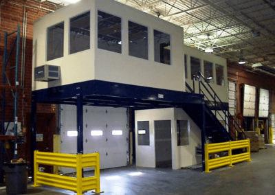 two story inplant office with mezzanine level above garage door